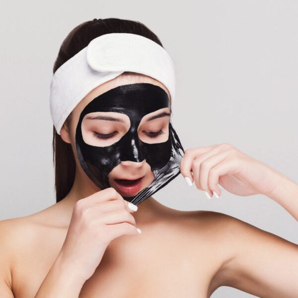 Girl with purifying black face mask